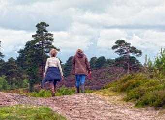 Two women walking cropped